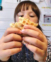Girl eats waffle
